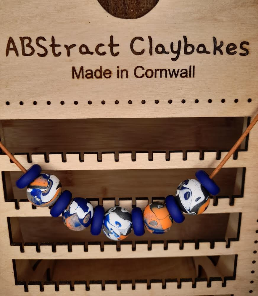 Polymer clay blue and orange print necklace by ABstract Claybakes