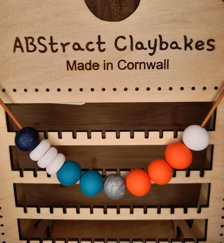Orange, blue and white  necklace by ABstract Claybakes