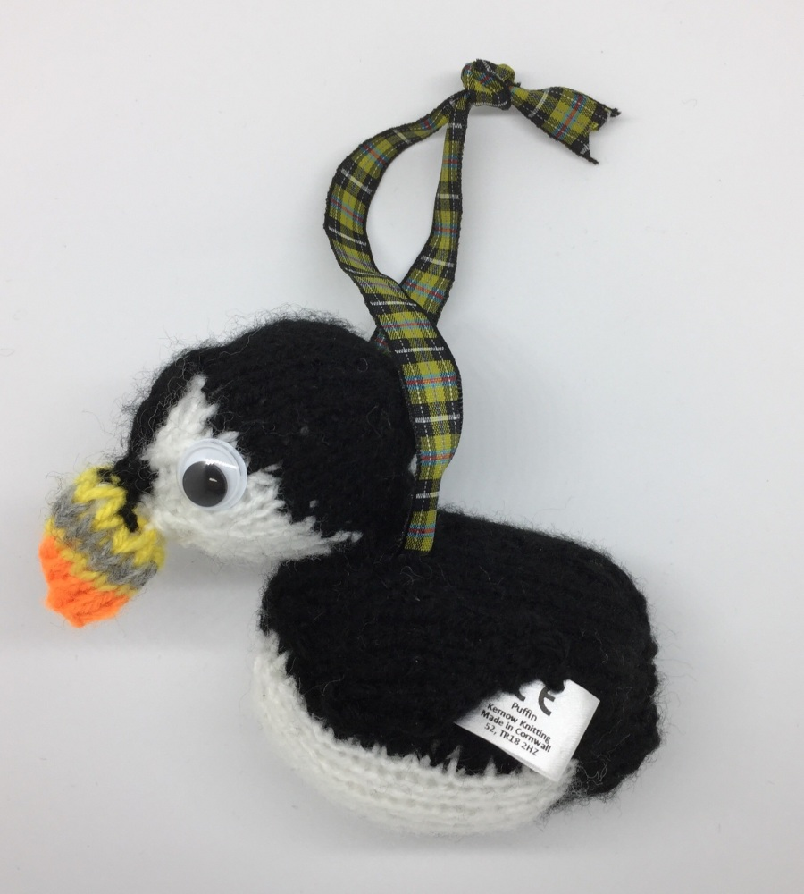 Small hand knitted puffin