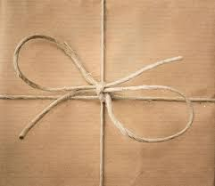 Parcel wrapped in brown paper tied with string