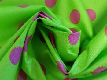Lime Green with pink spots, coated cotton, Shower proof. CO1079