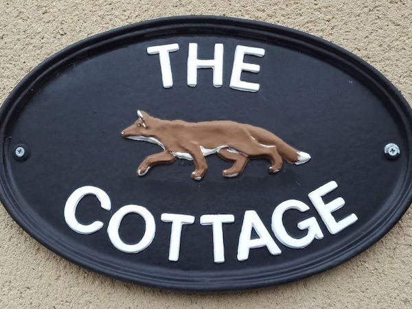 The sign on the Cottage