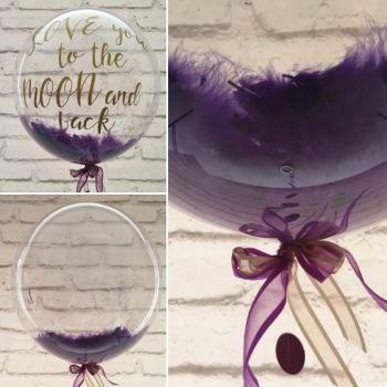 Purple feather balloon in a box