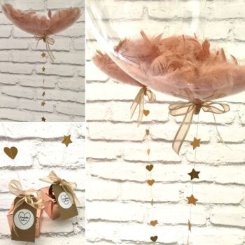 Rose gold feather balloon in a box