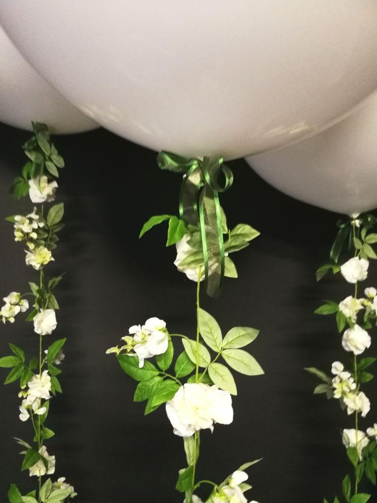 white giant with garlands