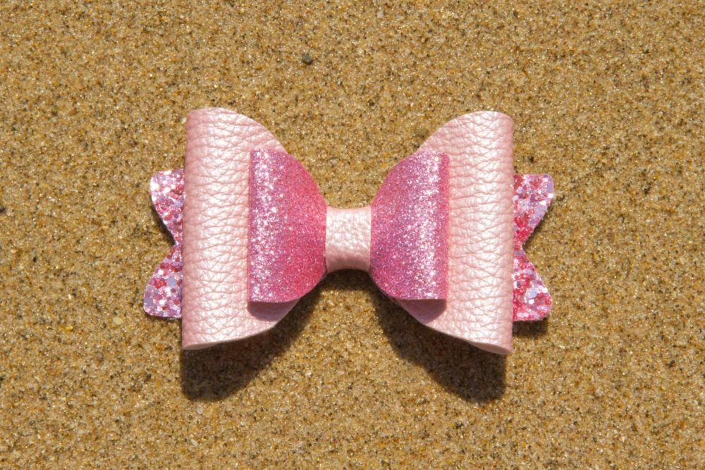 Pearl Effect Leatherette Bow in Pink