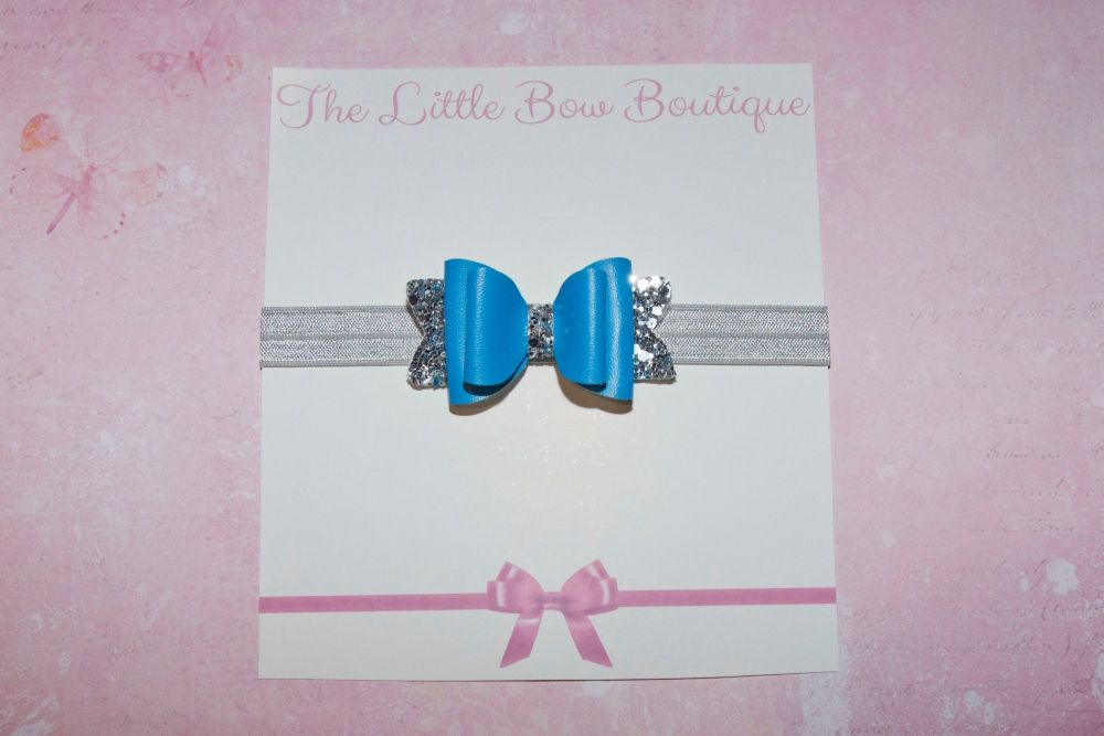 Blue Leatherette on Silver Glitter Baby Bow