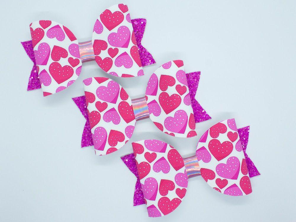 Love Heats Love Pink Bow