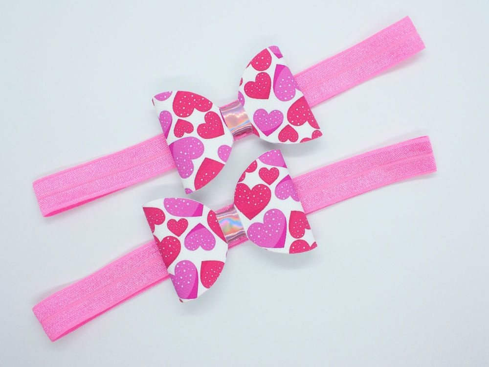 Love Heats Love Pink Baby Bow