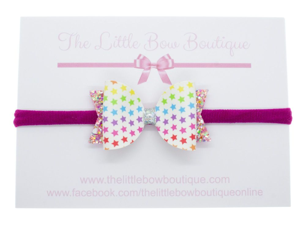 Stars in her eyes - Small Bow on Headband or Clip