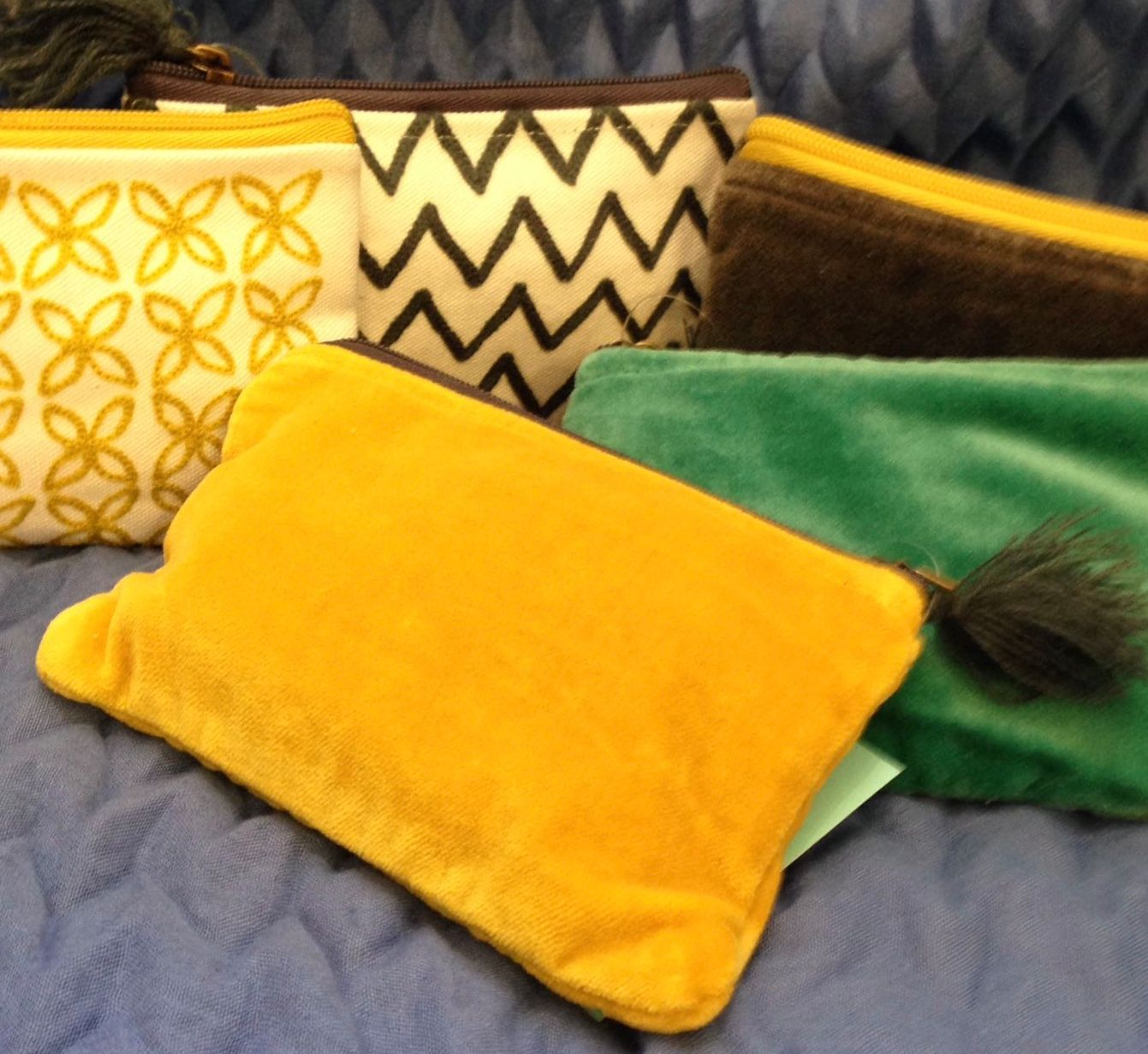 Pom's selection of velvet and embroidered purses
