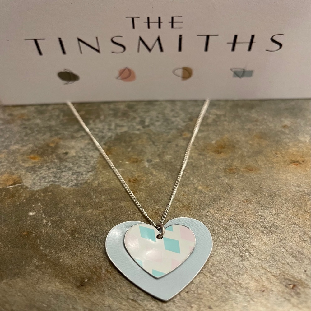 The Tinsmiths round double heart necklaceq