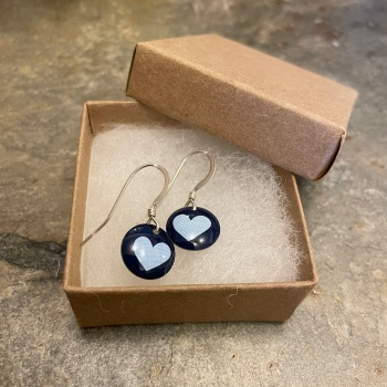 The Tinsmiths round earrings with heart pattern
