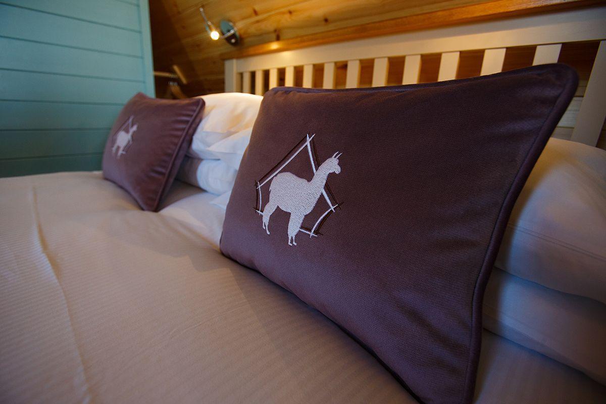 Alpaca logo on lodge cushion