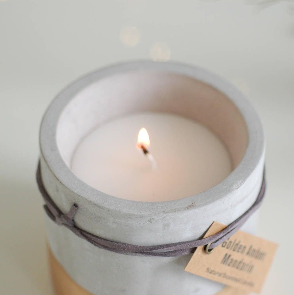 Large concrete, gold-dipped candle