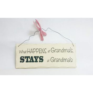 What Happens at Grandma's Wooden Sign