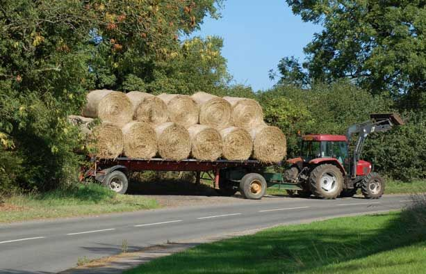 round-hay-bales-on-tractor