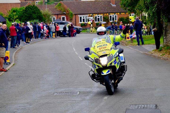 waving police motorcyclist