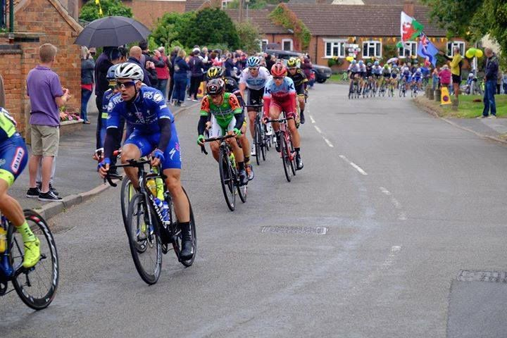 tour cyclists coming through the village