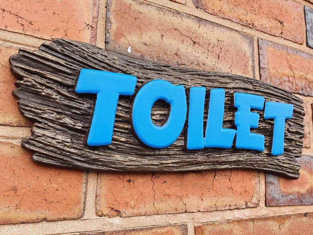 Themed Toilet Sign