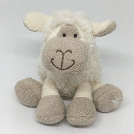 Mini white sitting sheep