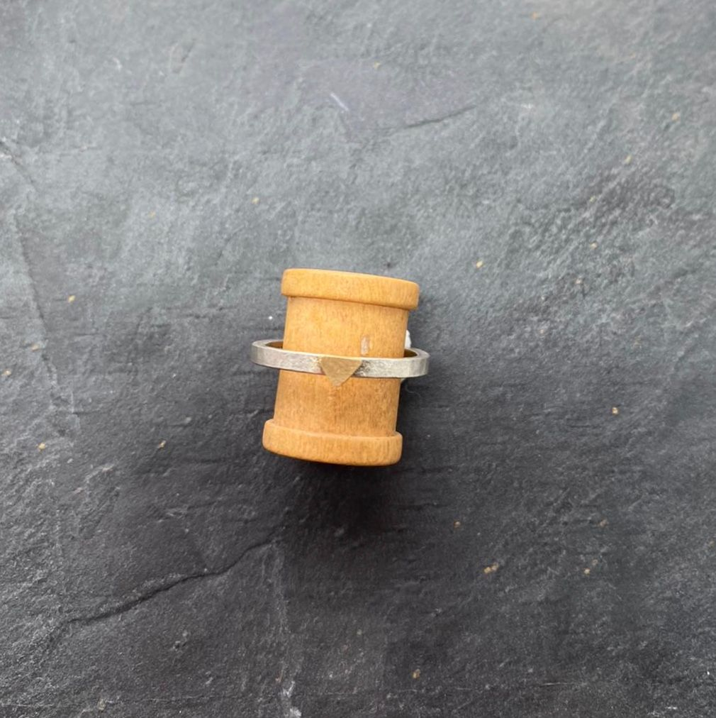Silver and 18ct yellow gold ring.