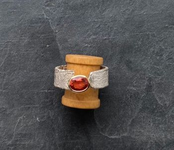 Silver and 9ct gold. Orange sapphire ring.