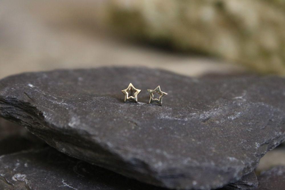 Yellow gold star stud earrings