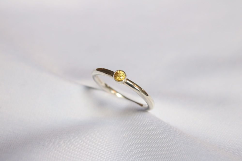 Yellow sapphire, silver ring.