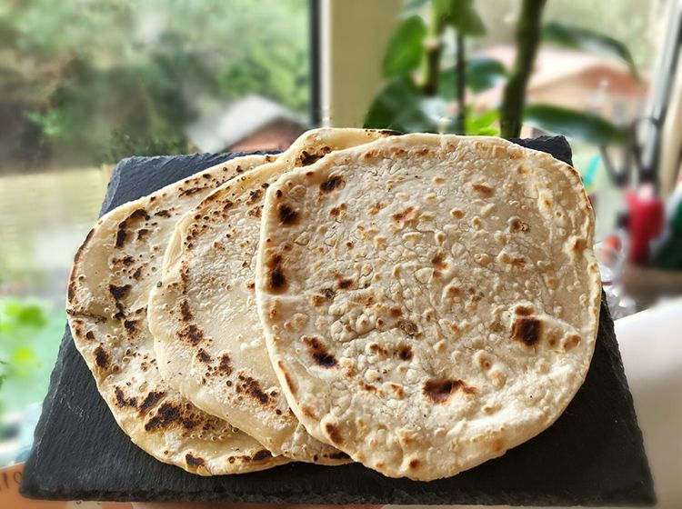 3 chapatis on a slate mat