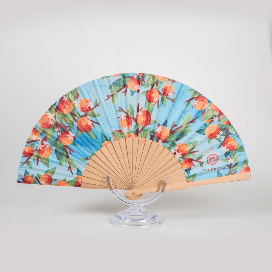 La Postalera: Hand Fan Oranges on Azure background