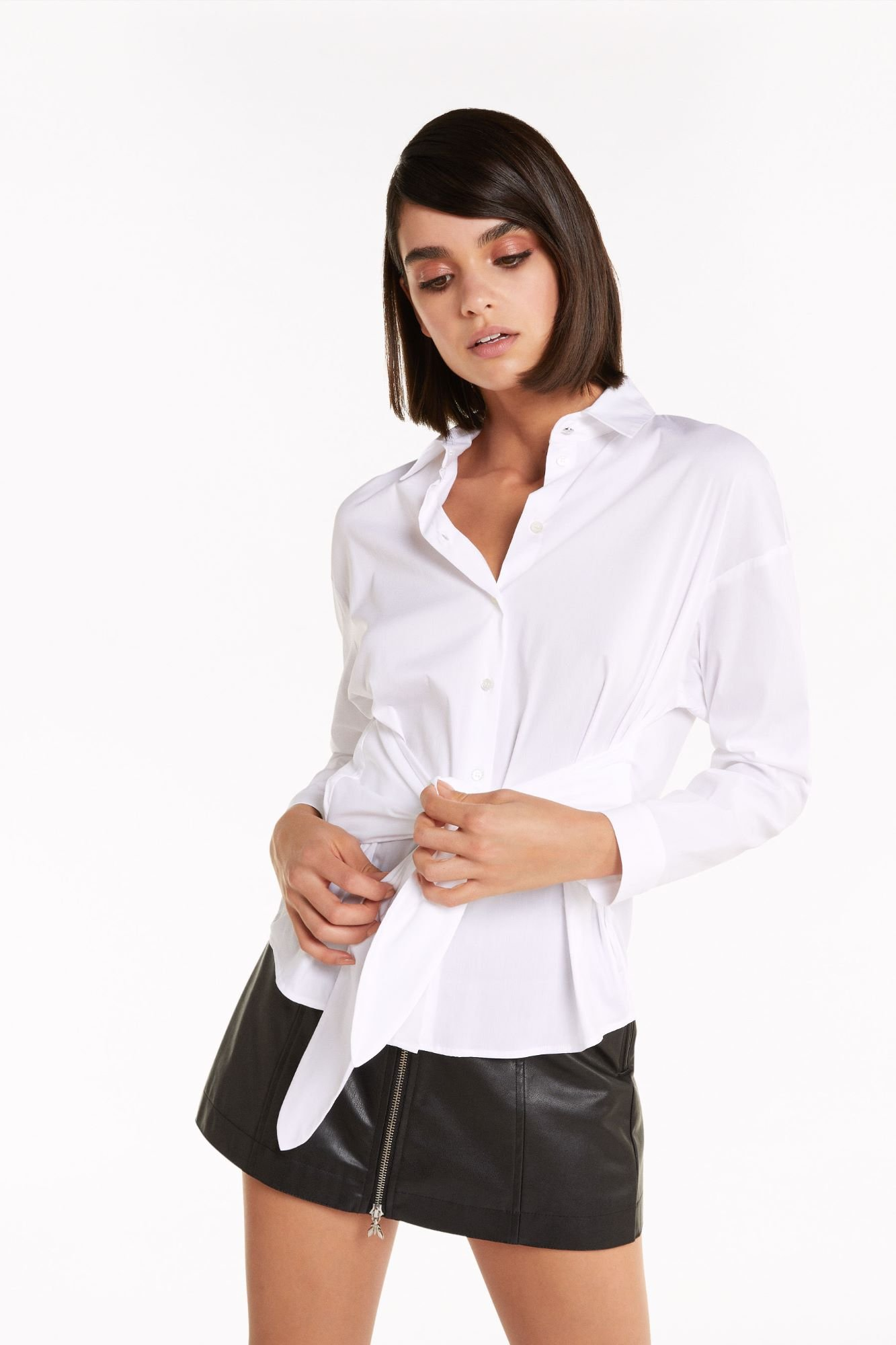 White blouse tie at front.jpg