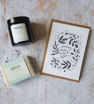 Hugs from afar card with amber glass jar candle and Mella soap