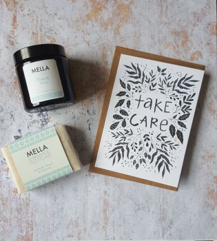 Take Care card with amber candle jar and Mella soap