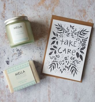 Take Care card with frosted glass candle jar and Mella soap