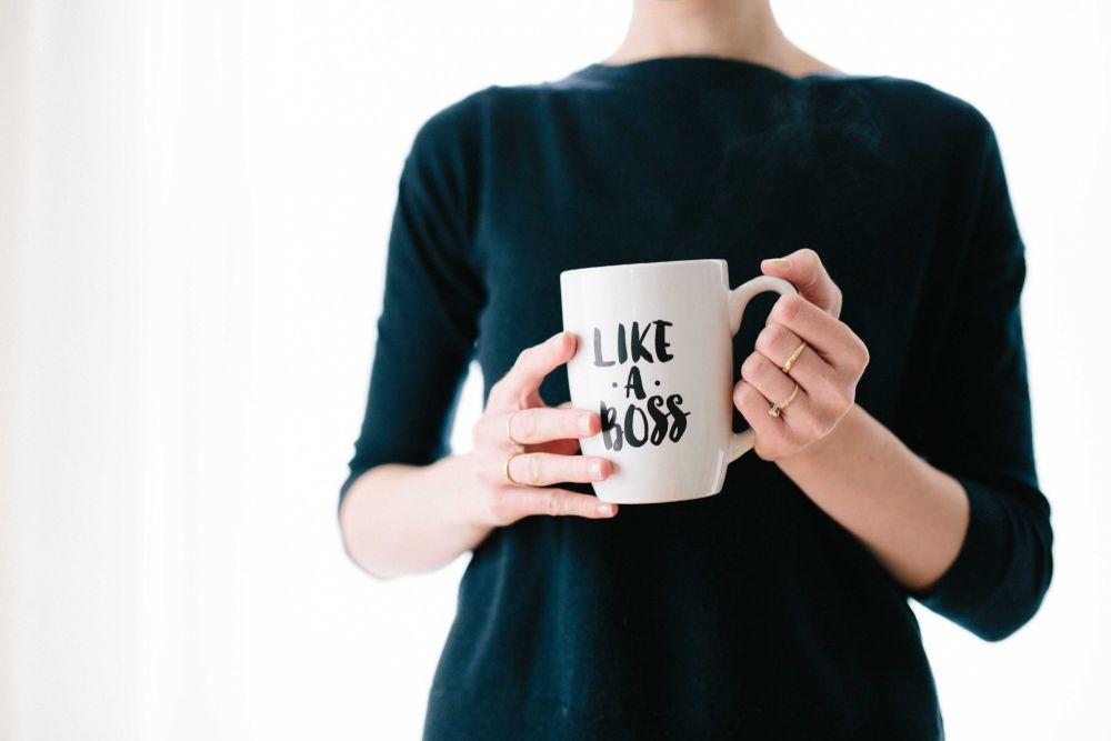 """Woman holding a """"Like a Boss"""" mug"""