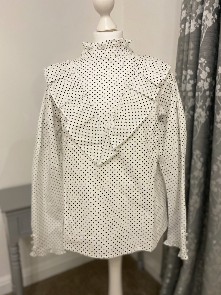 White & black polka dot frill high neck blouse