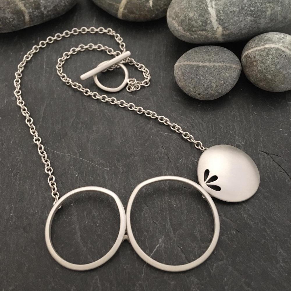 Pierced necklace