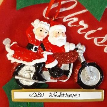 Mr & Mrs Claus on their Motorcycle
