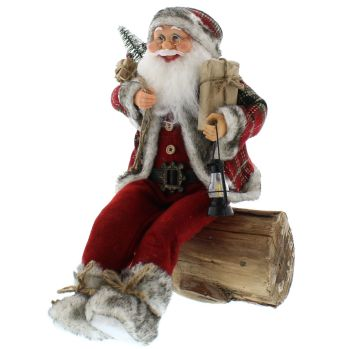 A Wonderful Jolly Santa sitting on a Log Decoration - 45cm tall