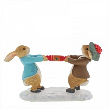 Beatrix Potters Peter Rabbit & Benjamin Bunny pulling a Cracker - 7cm high x 4 deep x 9 long.