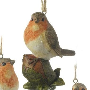 Gorgeous Robin Red Breast Bauble sitting on a Hazlenut