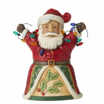 Jolly Santa holding a string of lights Figurine by Jim Shore's Heartwood Creek - 13cm tall x 10 wide x 8 deep.