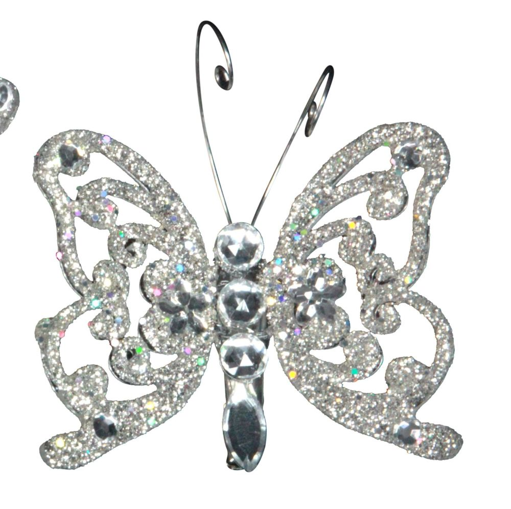 A Stunning Silver & Bejewelled Glitter clip on Butterfly. We also have matc