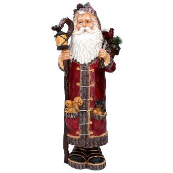 Rustic woodland Santa with lantern.