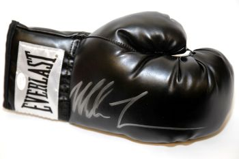Mike Tyson Signed Black Everlast Boxing Glove.