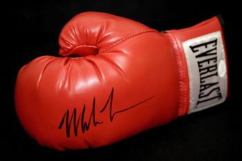 Mike Tyson Signed Red Everlast Boxing Glove.