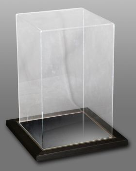 Acrylic Case With A Frame Surrounding A Mirror base.