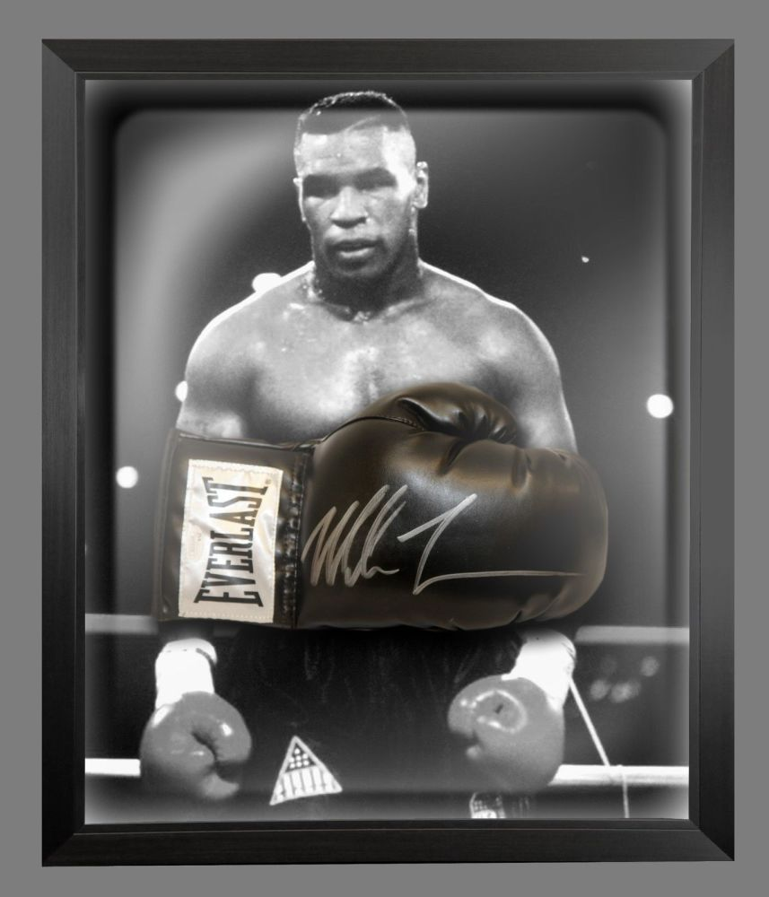 Mike Tyson Signed Black Everlast Boxing Glove In A Dome Frame.