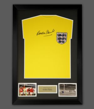 Gordon Banks Signed Replica Football Shirt In A Framed Presentation.